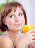 Cute female drinking juice Stock Images