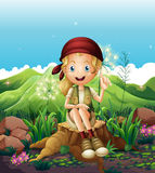 A cute female explorer sitting above the stump Royalty Free Stock Image