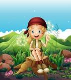 A cute female explorer sitting above the stump