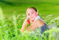 Cute female on floral field Stock Photo