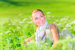 Cute female on floral field Royalty Free Stock Image