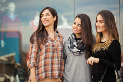 Cute female friends looking towards copy space. Portrait of a group of female friends ready to do some shopping at a mall and looking towards copy space Royalty Free Stock Photography