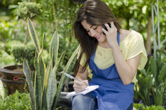 Cute female gardener at work Royalty Free Stock Photography