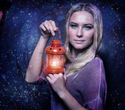 Cute female with glowing lantern Stock Photos