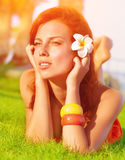 Cute female on green grass Royalty Free Stock Images