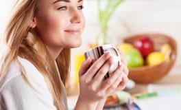 Cute female having coffee Royalty Free Stock Photos