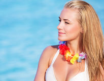 Cute female in Hawaiian leis Royalty Free Stock Photography