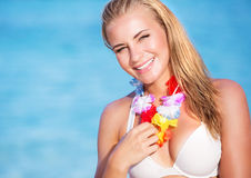Cute female in Hawaiian leis Royalty Free Stock Images