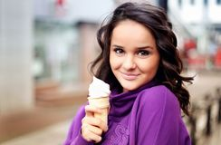 Cute female holding an icecream royalty free stock image