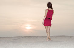 Cute Female In Red Dress Walking At The Desert