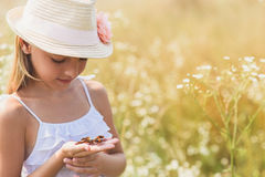 Cute female kid playing on field Royalty Free Stock Photography