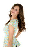 Cute female looking back wearing floral blouse Stock Photo