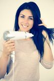 Cute female model drying her black hair Royalty Free Stock Photography