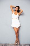 Cute female model in fashion white dress posing at studio Royalty Free Stock Images