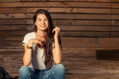 Cute female model smiling wearing jeans and t-shirt stock photo