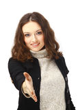 Cute female offering you a handshake. Portrait of a cute female offering you a handshake isolated over white Stock Image