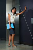 Cute Female Office Worker Casual Elevator Stock Photo