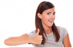 Cute female with ok sign looking at you Stock Photo