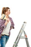 Cute female painter ready to paint. Royalty Free Stock Photo