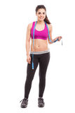 Cute female personal trainer. Pretty Hispanic personal trainer and diet coach holding a measuring tape and smiling Stock Photo