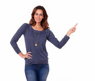 Cute female pointing to her left Royalty Free Stock Photos
