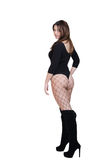 Cute female posing in the studio dressed in sexy bodysuit Royalty Free Stock Photography