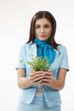 Cute female presenting plants Royalty Free Stock Photography