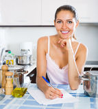 Cute female signing documents Stock Image