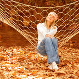 Cute female in sitting in hammock Royalty Free Stock Photo