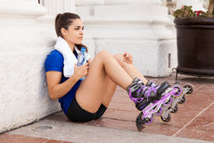 Cute female skater drinking water Stock Images