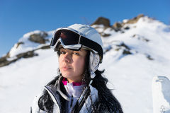 Cute female skier with serious expression Stock Photos