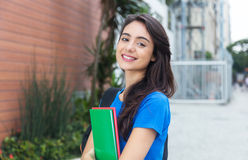 Cute female student with blue shirt in the city Stock Photography