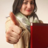 Cute female student with books, thumbs up (ok for school) Royalty Free Stock Photo