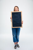 Cute female student holding blank board Royalty Free Stock Photos