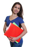 Cute female student with long dark hair and paperwork Stock Images