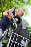 Cute female student standing with her bike Stock Image