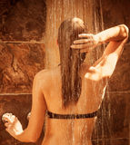 Cute female taking shower Royalty Free Stock Images