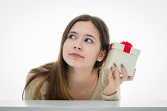Cheerful and excited teenager with gift box Stock Photography