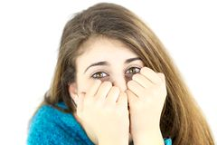 Cute female teenager hiding and playing Stock Images