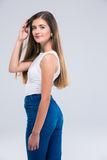 Cute female teenager touching her hair Royalty Free Stock Images