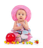 Cute female toddler with lollipop Stock Photos