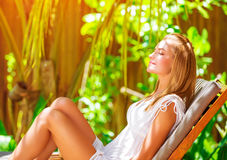 Cute female on tropical resort Stock Images