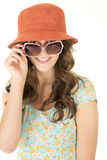 Cute female wearing orange hat and sunglasses Royalty Free Stock Photography
