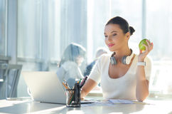 Cute female worker is resting in office Royalty Free Stock Photos