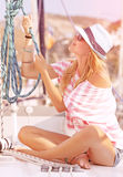 Cute female working on sailboat Stock Photos