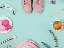 Cute feminine accessories and coffee on the pastel background. Top view stock photography