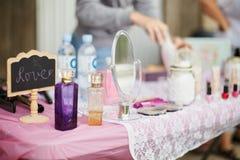 Cute feminine stuff on pink table. Royalty Free Stock Photo