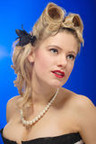 Cute fifties girl with victory roll hairstyle Royalty Free Stock Images