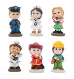 Cute Figures in Different Work Attire Stock Photo
