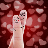 Cute finger sign of love. Cute finger sign language of a guy hugging his girlfriend on red background Royalty Free Stock Photos